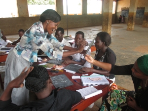 A teacher practising some of what she has learnt during a training session.