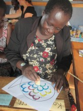 A nursery teacher working on her artwork.